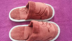 Producing and distributing women's and men's towel slippers